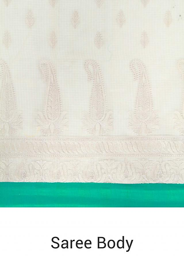 Beige silk saree adorn in paisley motif embroidery only on Kalki