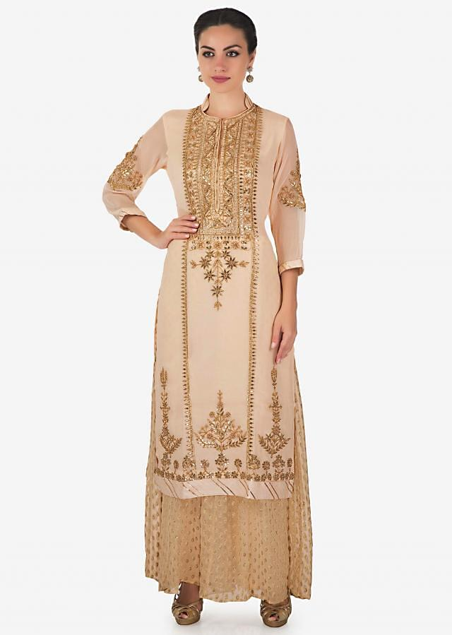 Beige straight palazzo suit in georgette adorn in gotta patch, zari and moti work only on Kalki