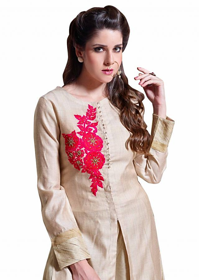 Beige straight suit featuring in thread and kardana embroidery only on Kalki