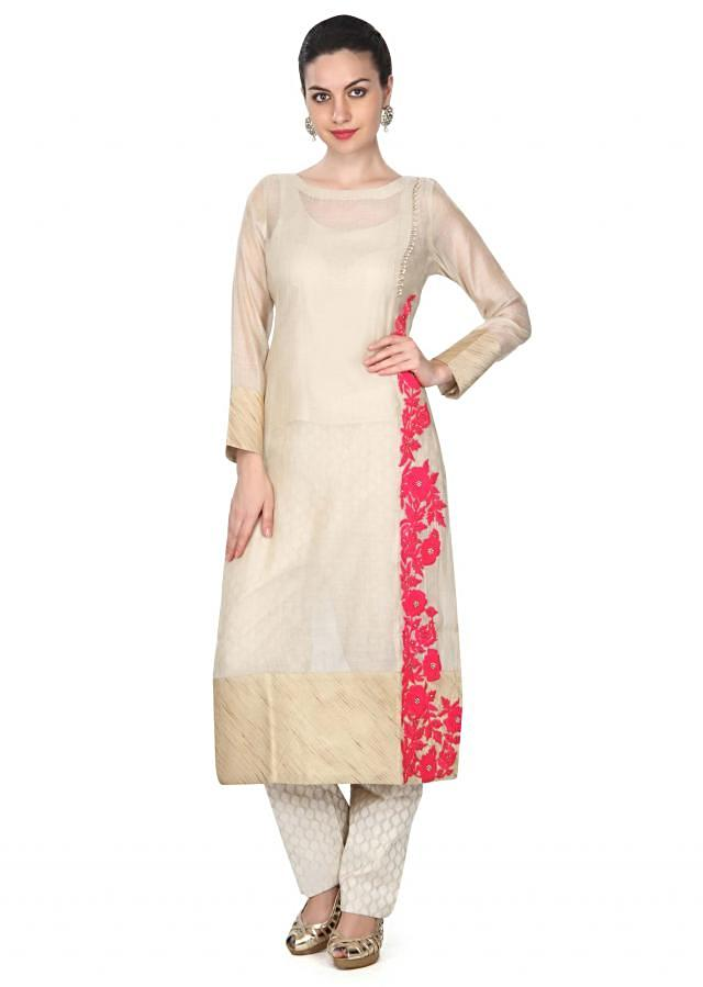 Beige straight suit in thread embroidery only on Kalki