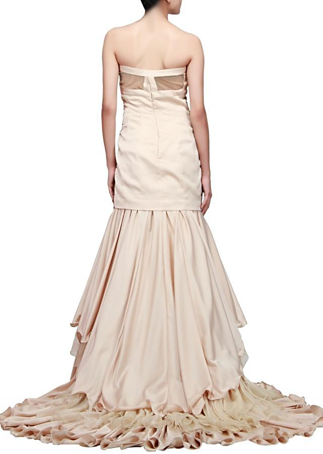 Beige strapless gown featuring with embroidered corset bodice only on Kalki