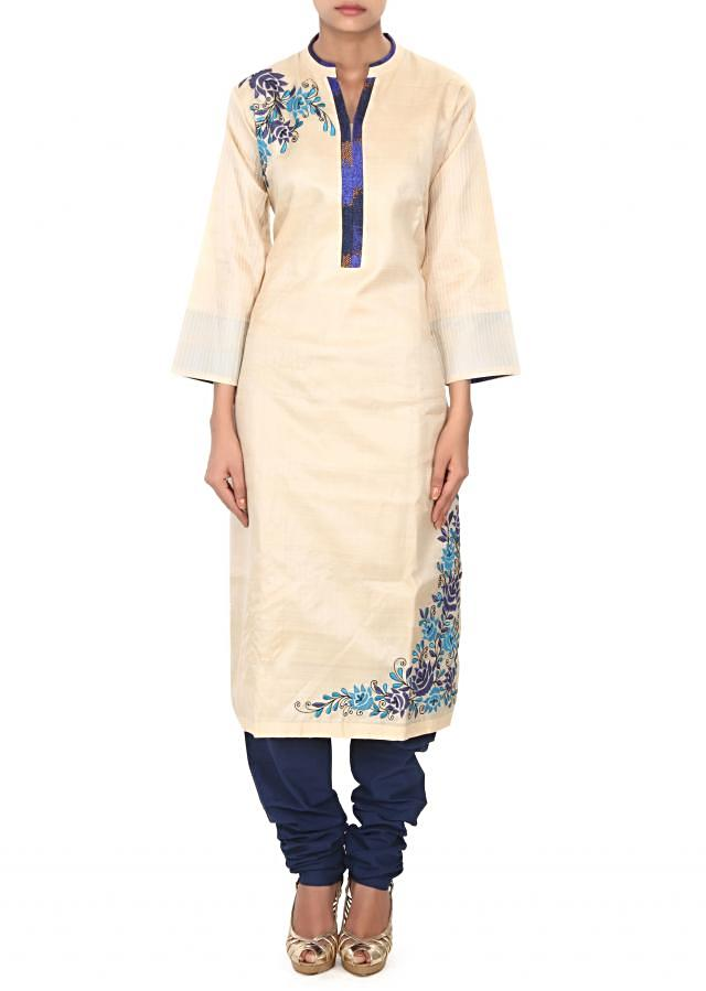 Beige straight suit adorn in resham and printed placket only on Kalki