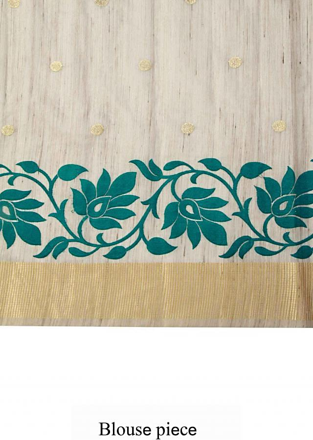 Beige tussar silk saree enhanced in weave embroidery only on Kalki