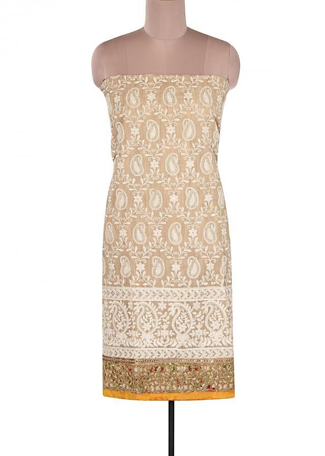 Beige unstitched suit adorn in thread embroidery in paisley motif only on Kalki