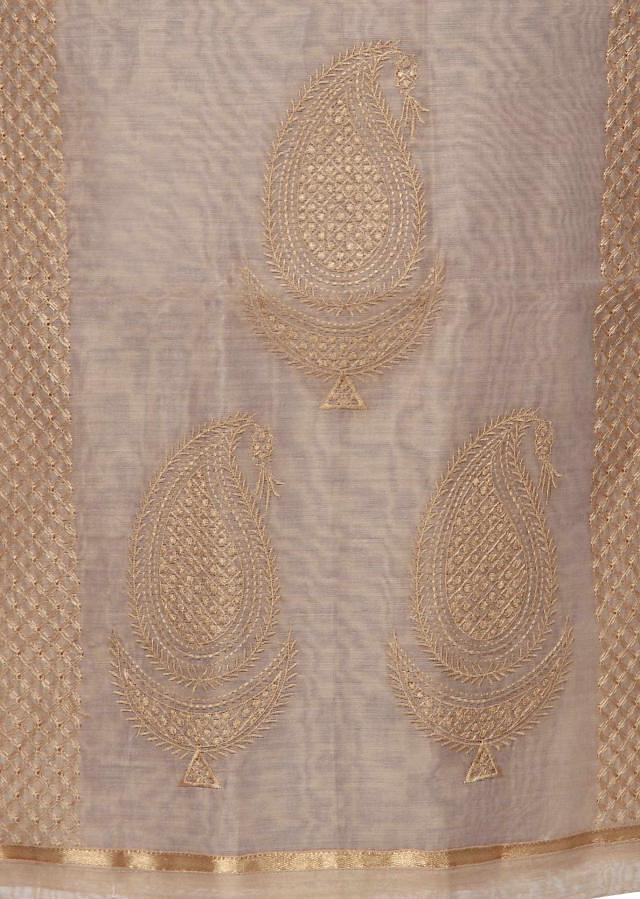 Beige unstitched suit adorn in thread embroidery only on Kalki