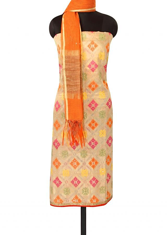 Beige unstitched suit adorn in weaved embroidery only on Kalki