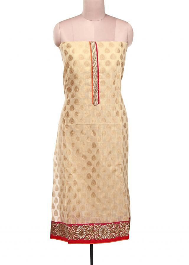 Beige unstitched suit adorn in zari embroidery only on Kalki