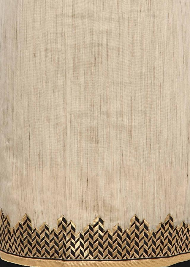 Beige unstitched suit enhanced in applique border only on Kalki