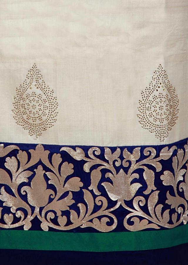 Beige unstitched suit enhanced in applique embroidery only on Kalki