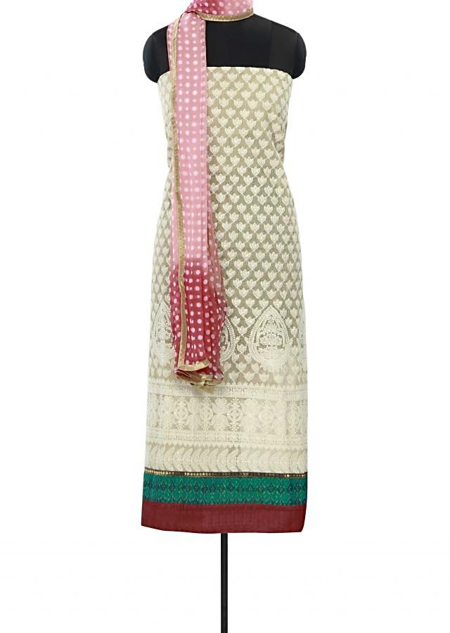 Beige unstitched suit enhanced in thread embroidery only on Kalki