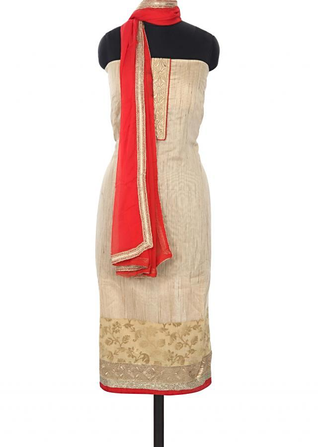 Beige unstitched suit enhanced in zari placket only on Kalki