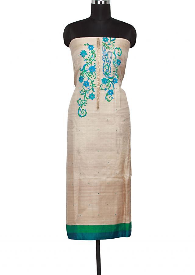 Beige unstitched suit featuring in thread embroidery only on Kalki