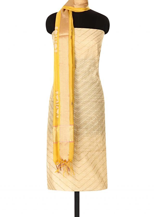 Beige unstitched suit in zari and thread only on Kalki