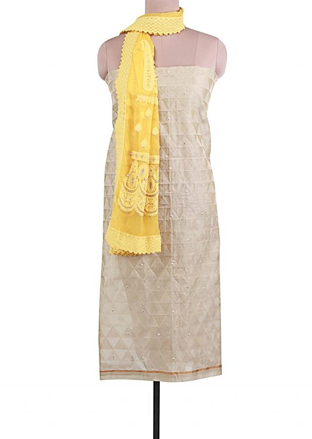 Beige unstitched suit adorn in thread and mirror embroidery only on Kalki