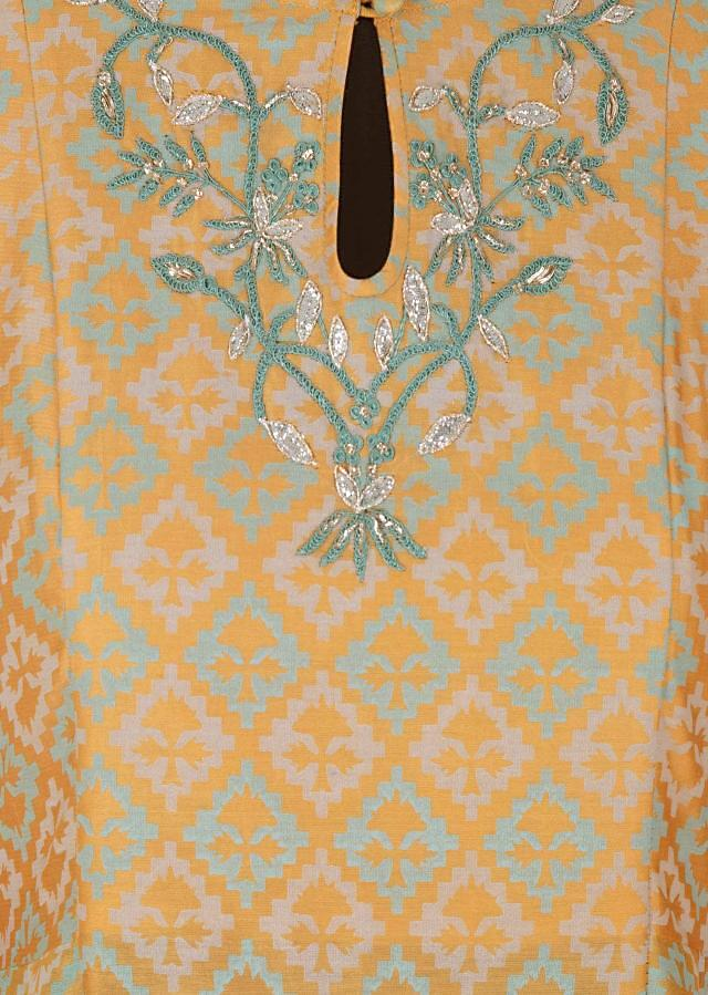 Beige yellow printed kurti with resham embroidered neckline and key hole opening only on Kalki