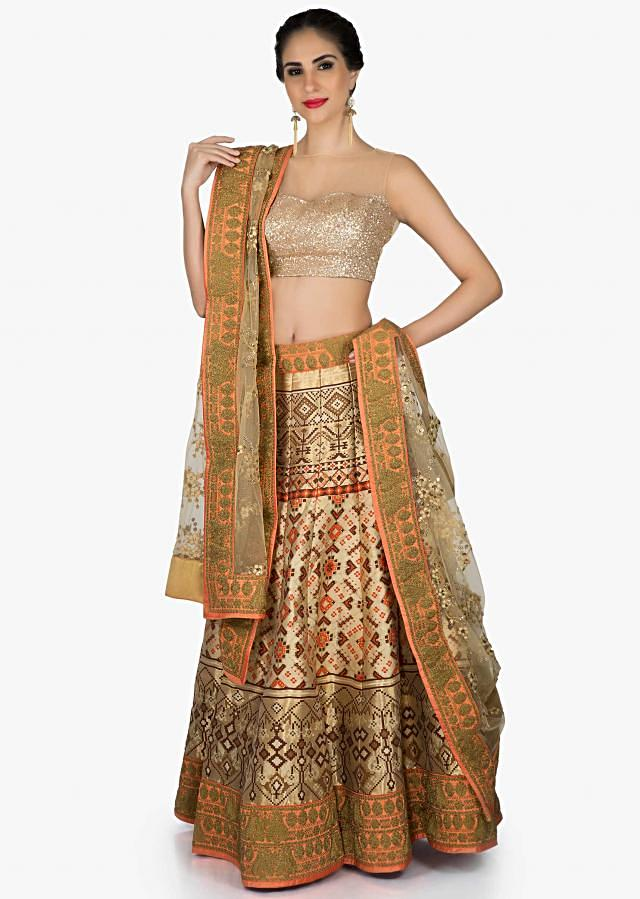 Beige and brown lehenga in ikkat motif print with thread embroidered net dupatta only on Kalki