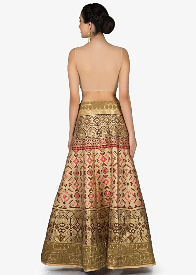 Beige and olive lehenga in ikkat motif print with thread embroidered net dupatta only on Kalki
