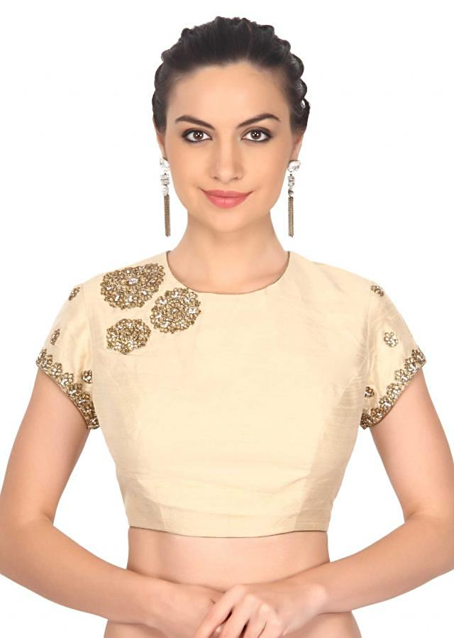 Beige blouse adorn in kundan and zardosi embroidery only on Kalki
