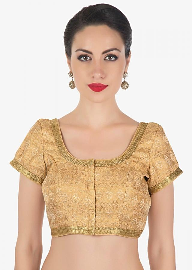 Beige brocade blouse highlighted in gold lace only on Kalki