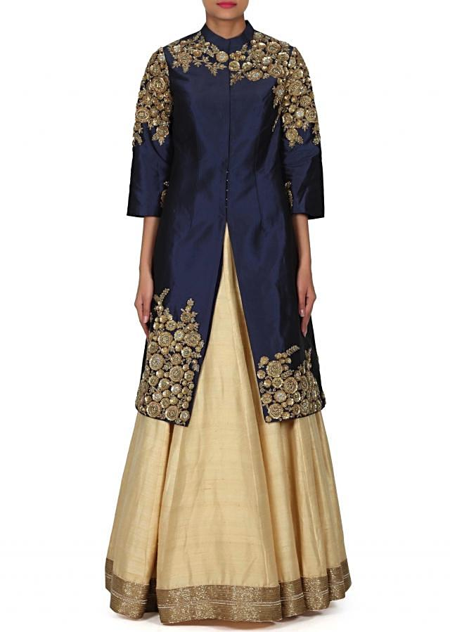 Beige lehenga adorn in zari and sequin embroidery only on Kalki