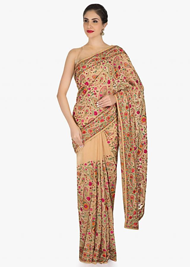 Beige saree in georgette beautified in paisley motif with resham and cut dana work only on Kalki