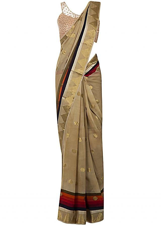 Beige saree in weave butti with multi color border only on Kalki