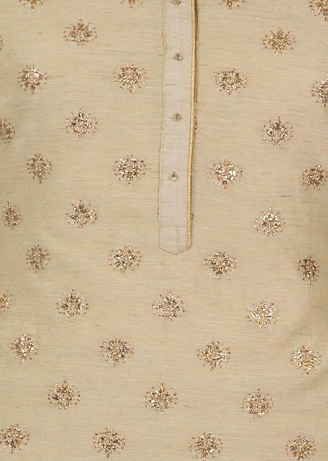 Beige semi stitched suit embellished in zari embroidered butti only on Kalki