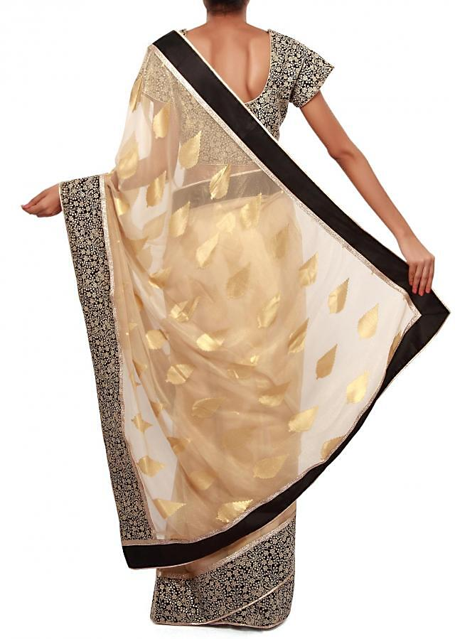 Beige shimmer saree adorn in weave and thread embroidery only on Kalki