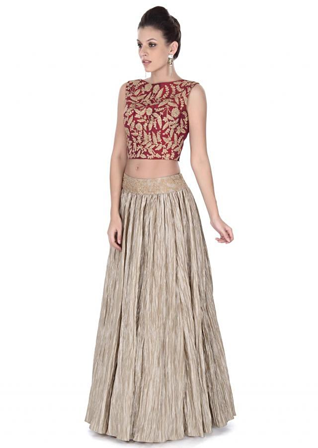 Beige skirt matched with red embroidered crop top only on Kalki