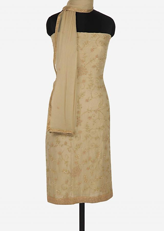 Beige unstitched suit in shimmer georgette embellished in moti and cut dana work only on Kalki