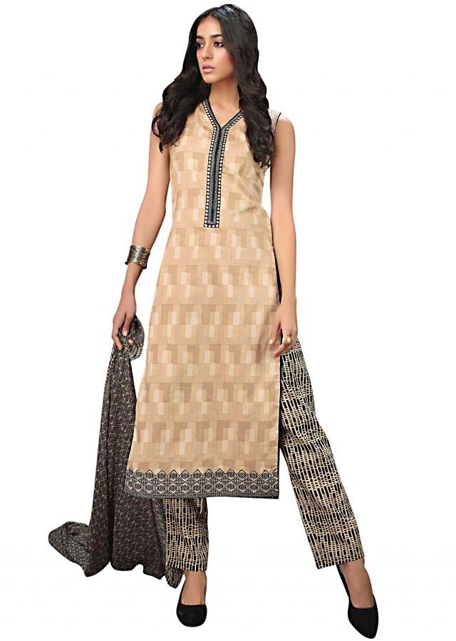 Beige unstitched suit with black printed placket