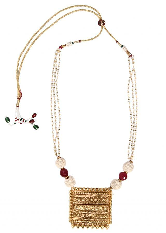 Big gold locket with white beaded chains works well on simple and elegant attire only on Kalki