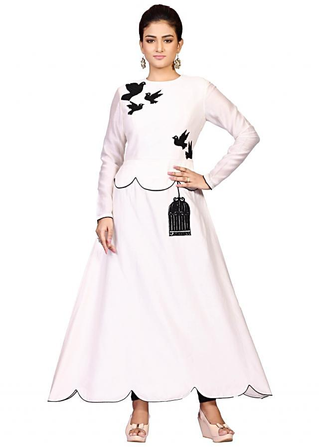 Bird Peplum off white suit in chanderi featuring the splendid thread embroidery work only on Kalki