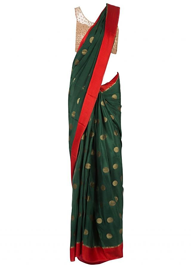 Bistro green saree in weave butti with contrast border only on Kalki