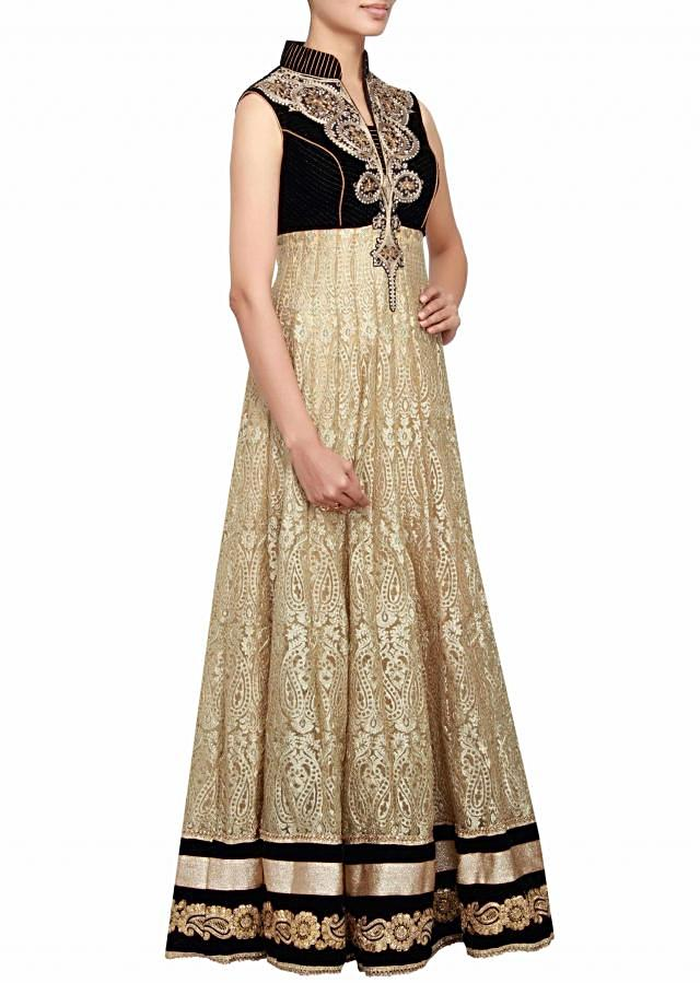 Black and gold anarkali in velvet and net embellished in zari and patch work only on Kalki