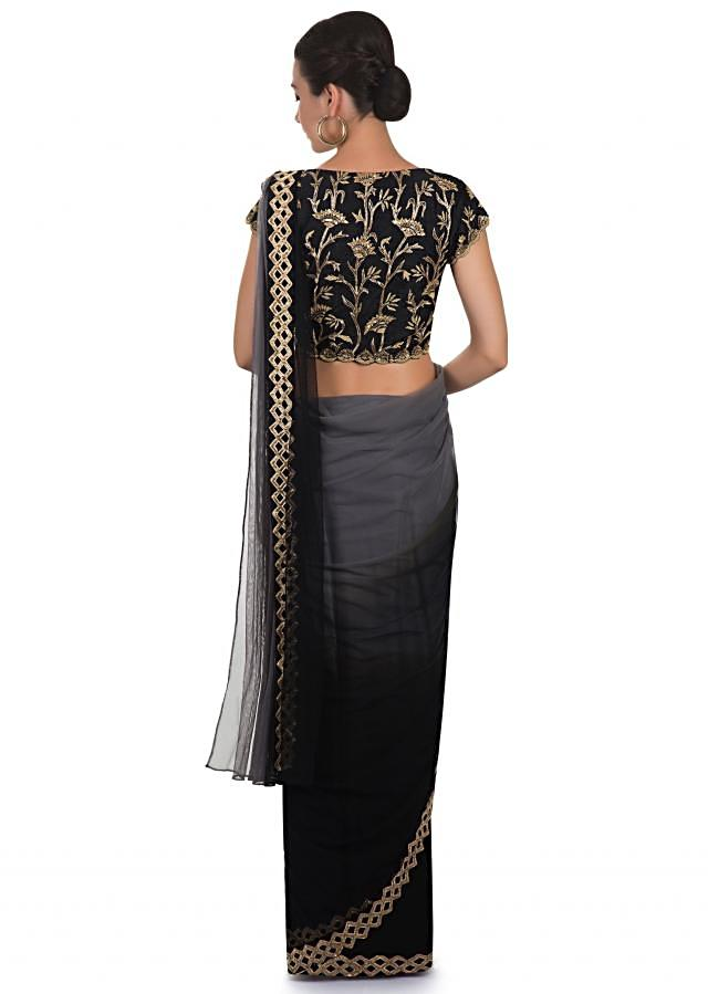 Black and grey net saree embellished with cut dana work only on Kalki