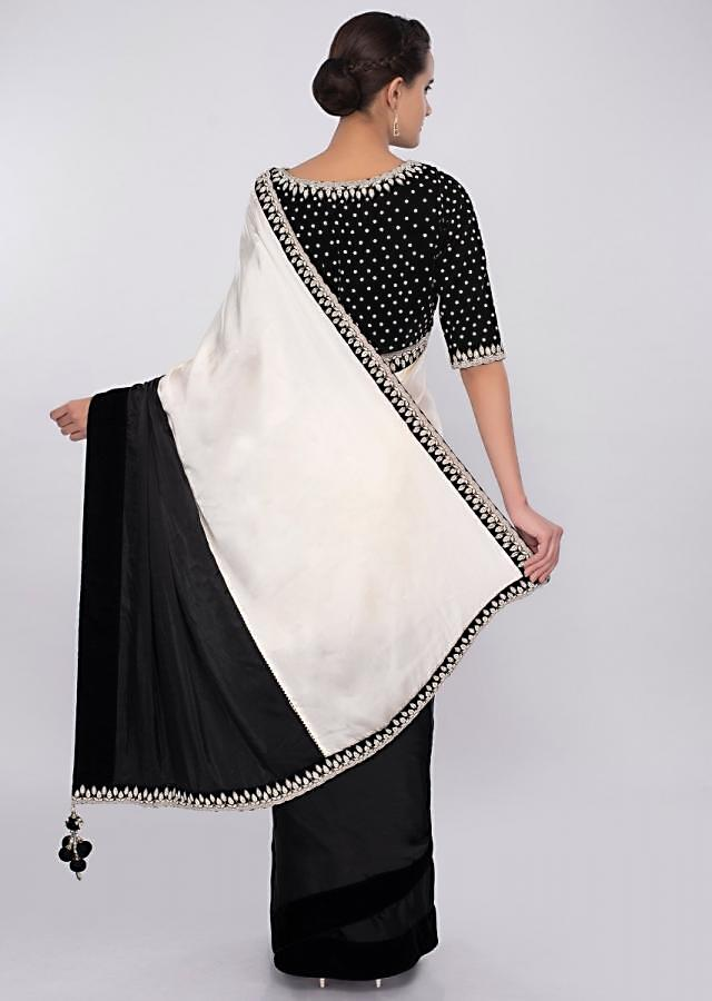 Black and white satin saree with embroidered velvet border only on kalki
