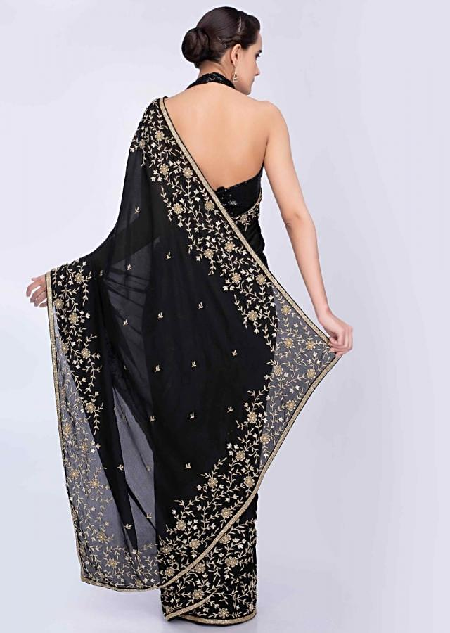 Black chiffon saree with butti and heavy embroidered border only on Kalki