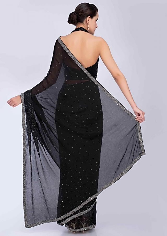 Black chiffon saree with heavy cut dana and pot embroidered border only on Kalki