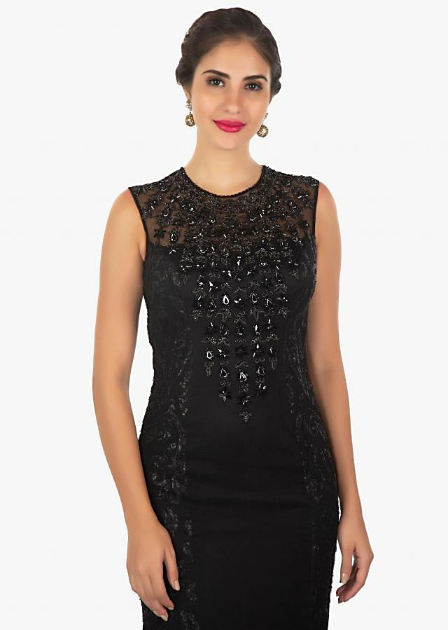 Black jewel neck gown featuring in texture net only on Kalki