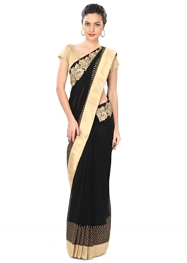 Black saree adorn in aari and cut work border only on Kalki