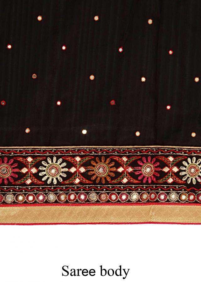 Black saree adorn in mirror and resham embroidery only on Kalki