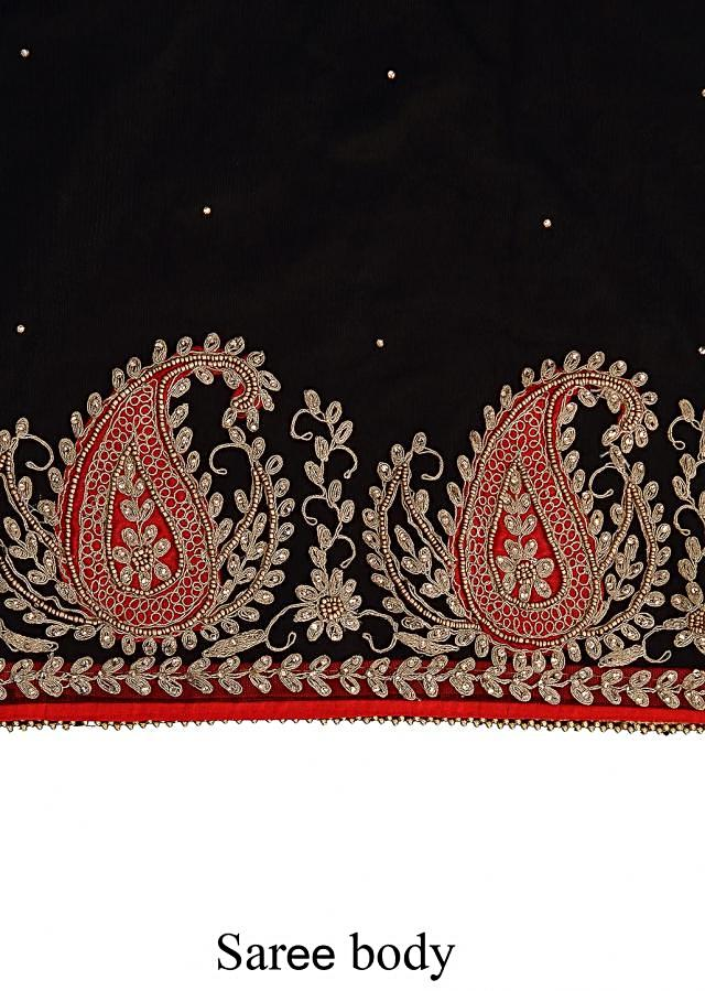 Black saree adorn in paisley motif embroidery only on Kalki