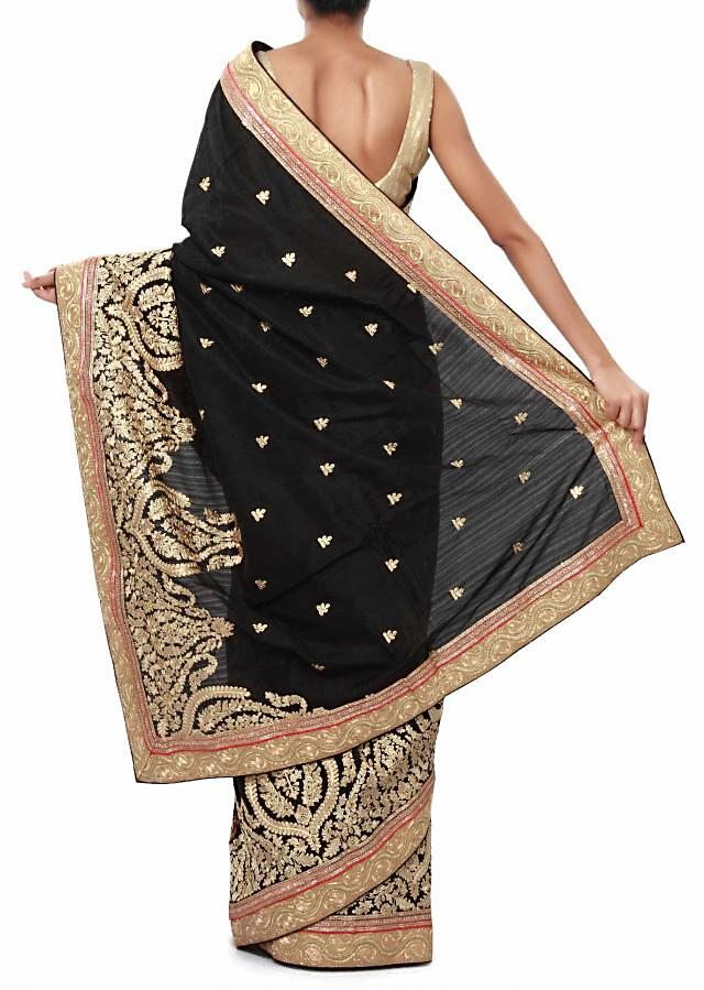 Black saree adorn in resham and zari embroidery only on Kalki