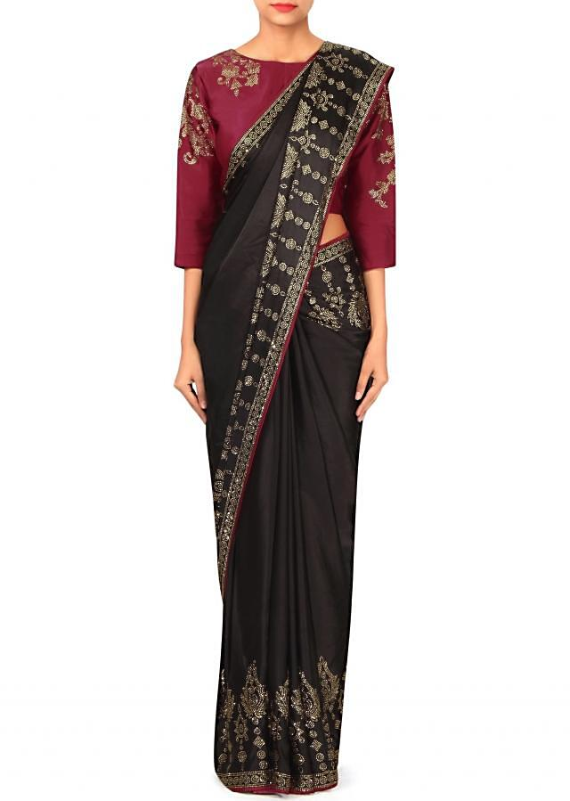 Noir black saree embellished in kundan with ready blouse only on Kalki