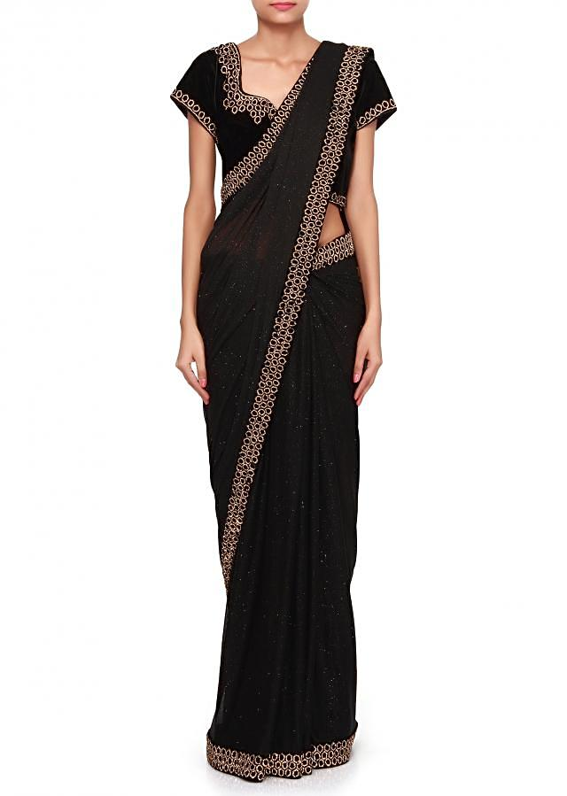 Black saree enhanced in kundan embroidery only on Kalki