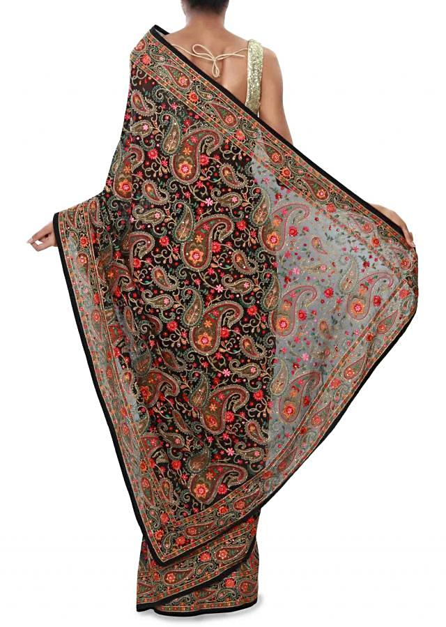 Black saree enhanced in resham Kashmiri embroidery in paisley motif only on Kalki