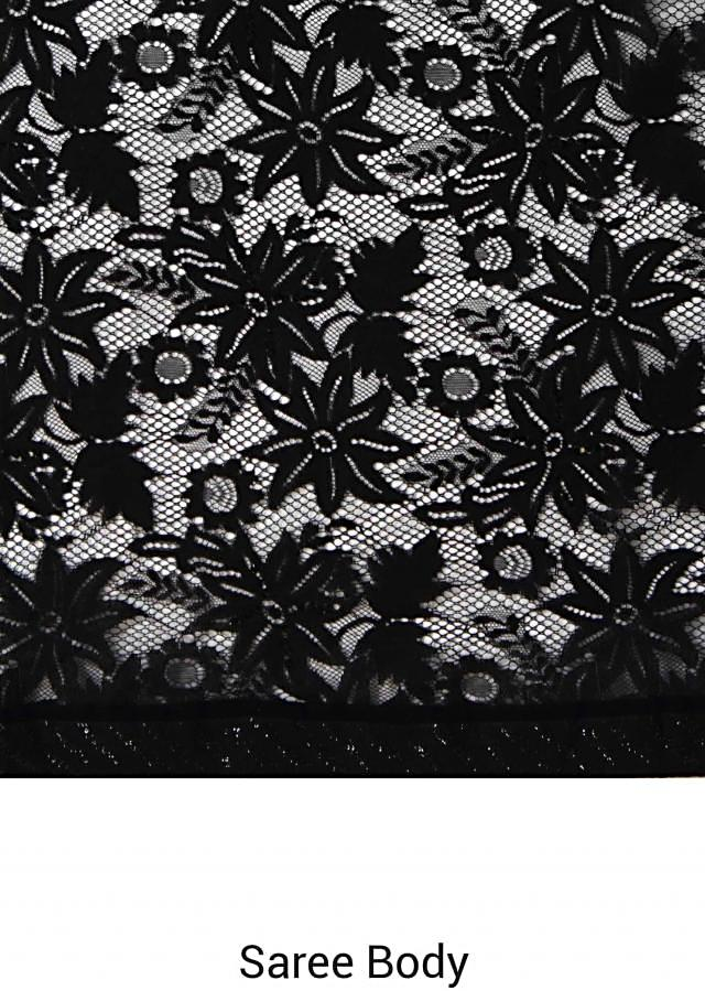 Lacy black saree in lace with sequin border only on Kalki