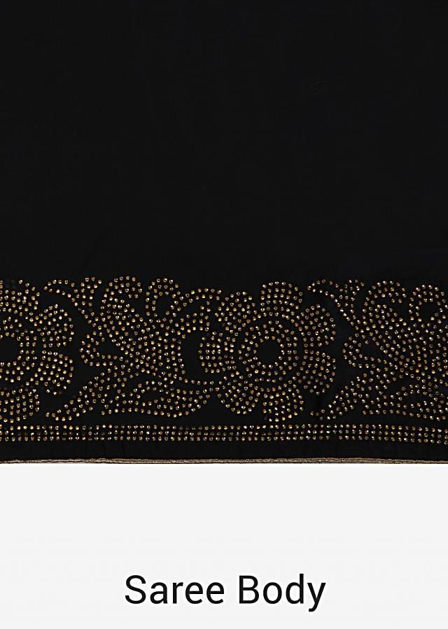 Black saree in with kundan border and gold unstitched blouse only on Kalki