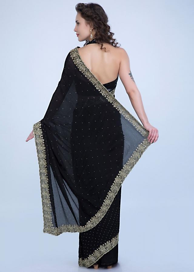 Black satin chiffon saree with heavy floral embroidered border only on Kalki